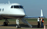 Gulfstream jet waiting for town car and limosine